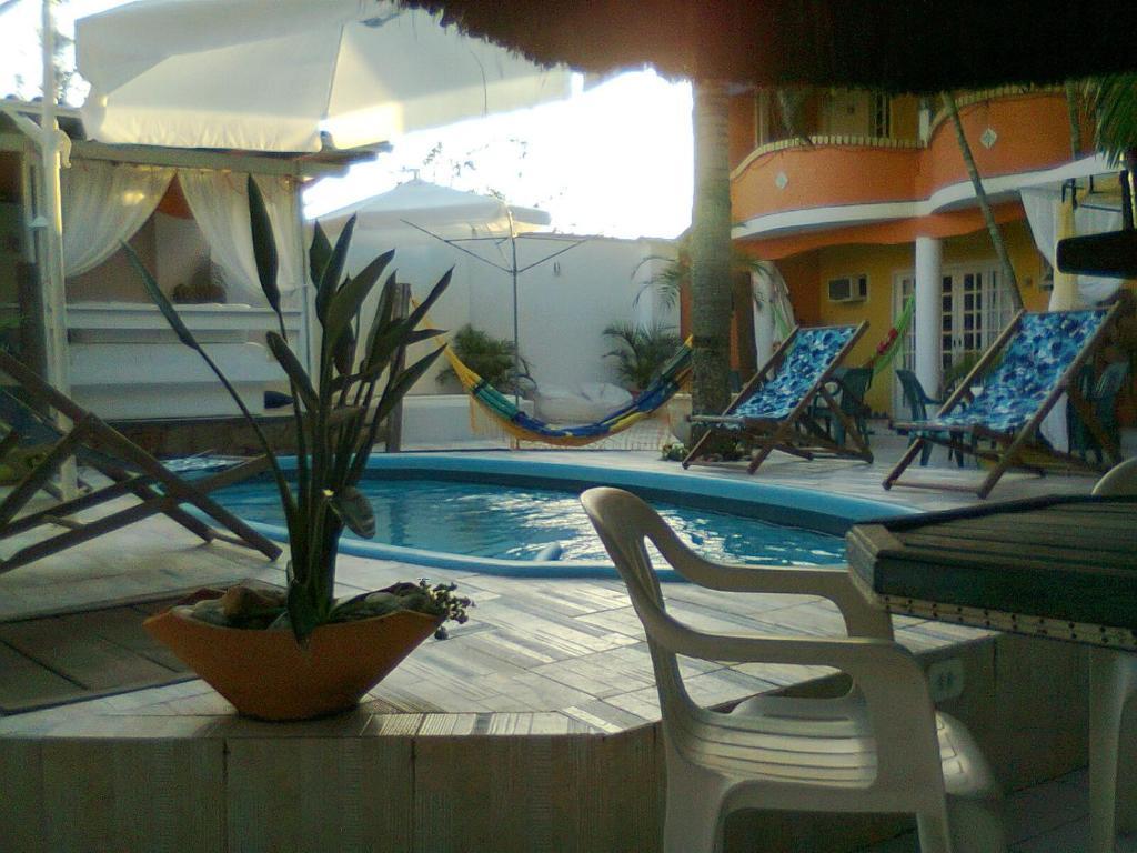 The swimming pool at or near Pousada Âncora