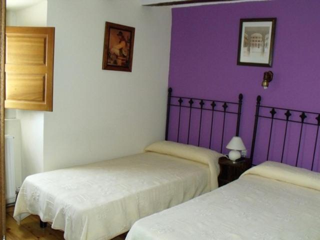 Cama o camas de una habitación en Hotel Rural Papasol