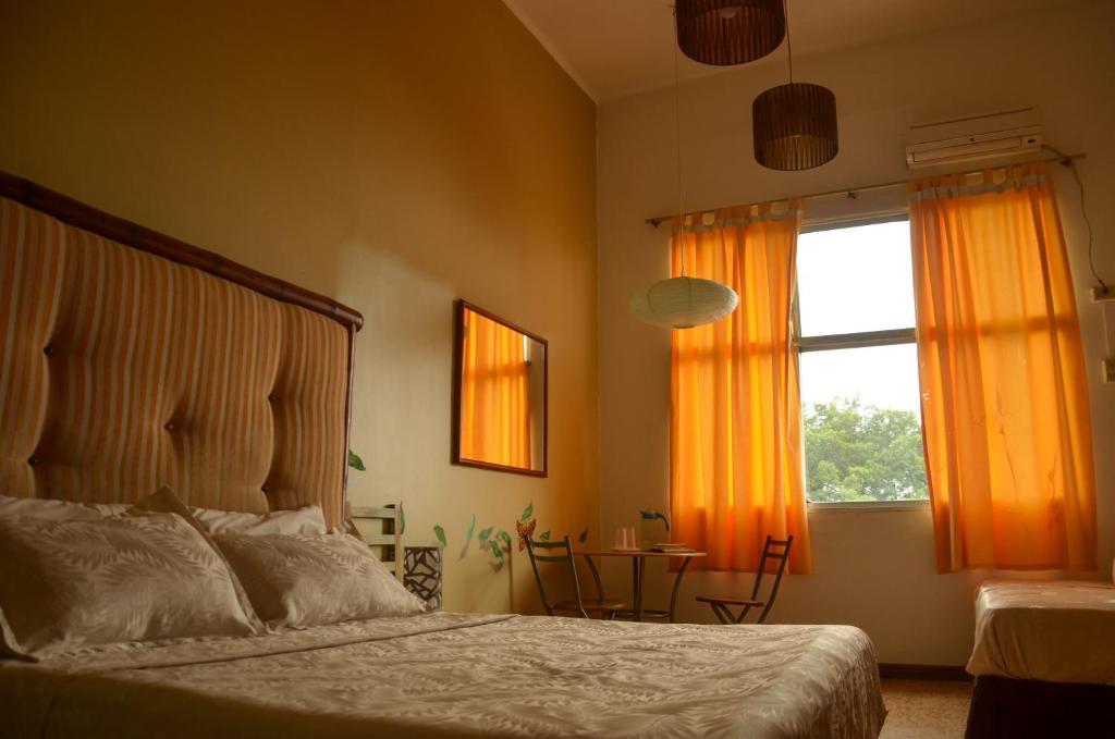 מיטה או מיטות בחדר ב-Manso Boutique Guest House