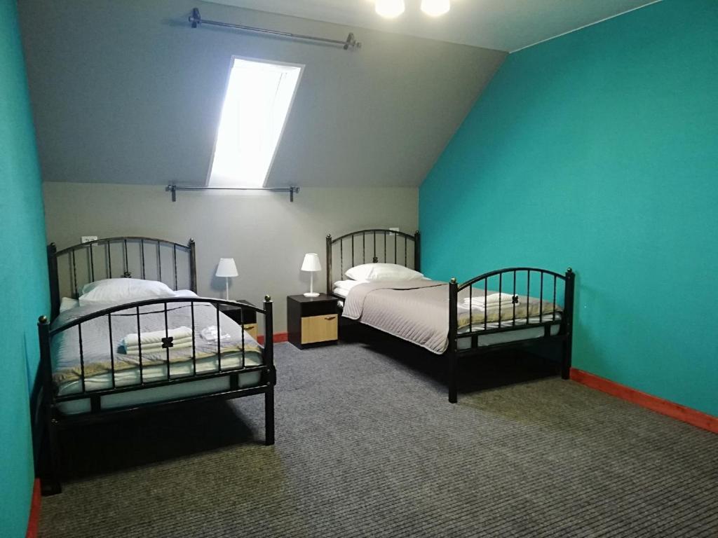 Кровать или кровати в номере Отель Рауту