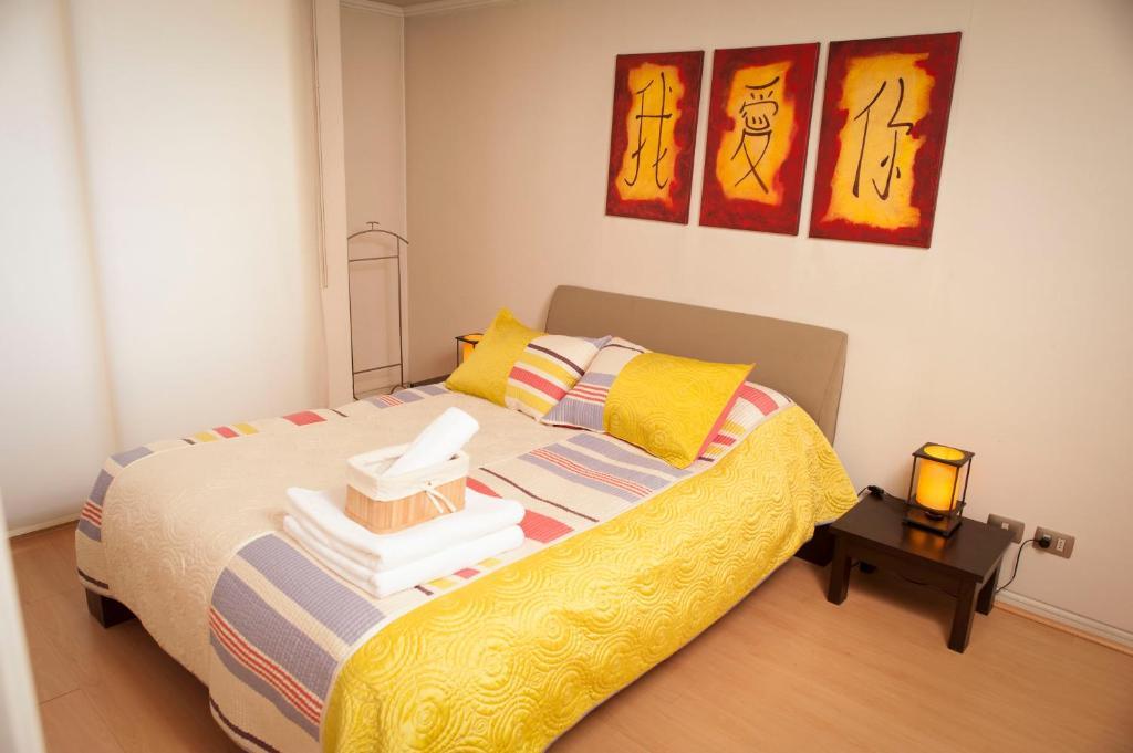 Cama o camas de una habitación en Chilean Suites Providencia