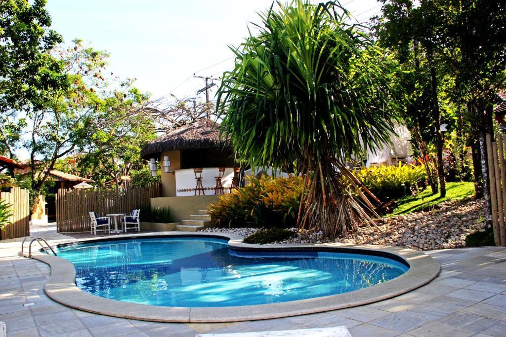 The swimming pool at or near Pousada Coisa e Tao