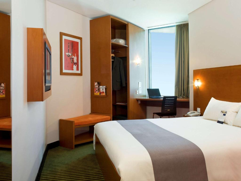 A bed or beds in a room at Ibis Amman