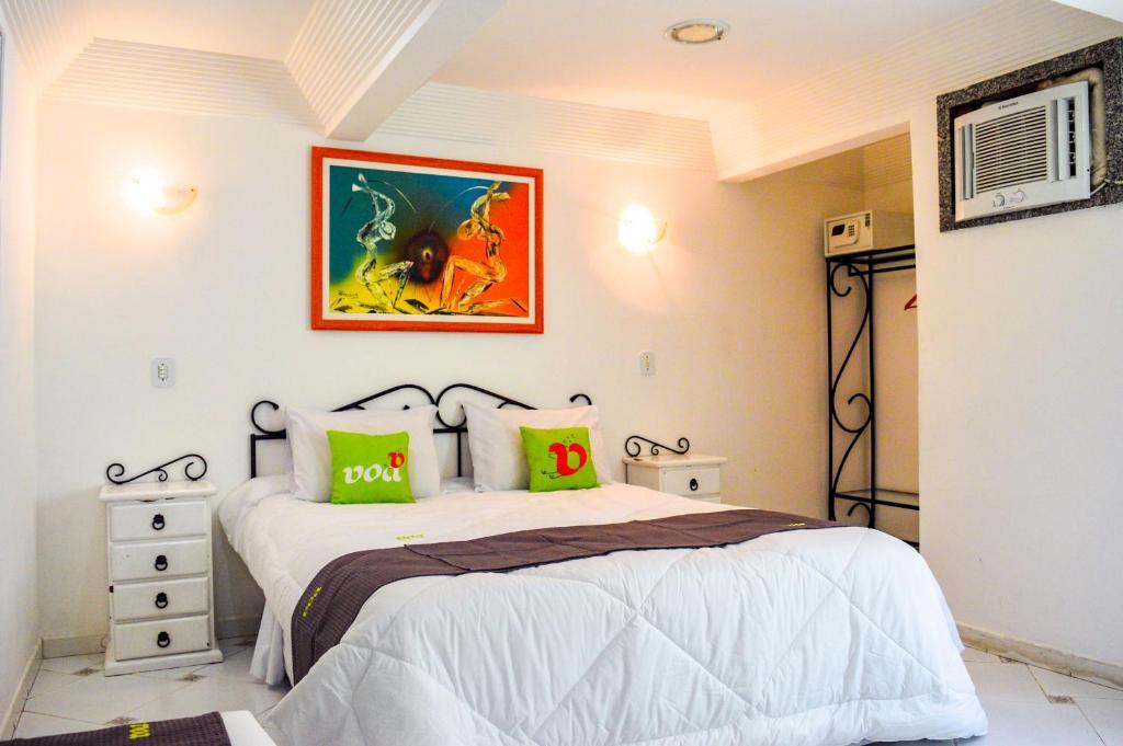 Cama ou camas em um quarto em VOA Plaza Búzios
