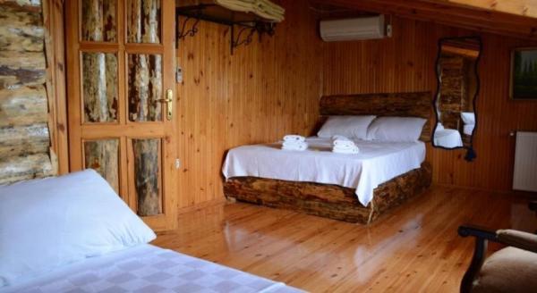 Кровать или кровати в номере ALA OTEL KONUK EVİ AĞVA