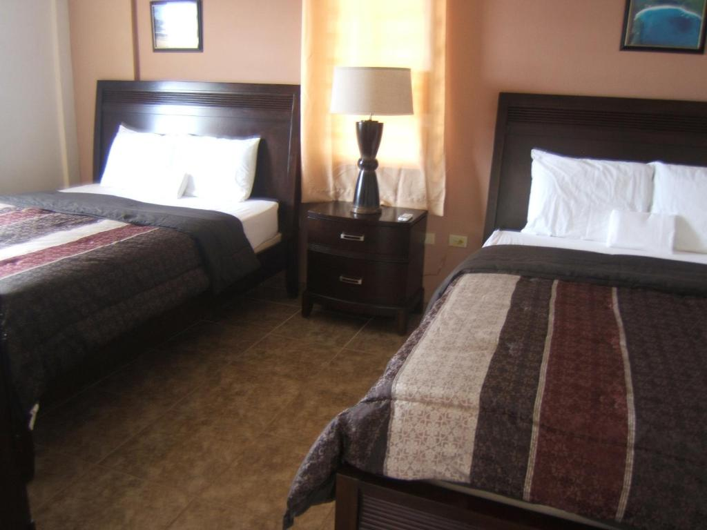 A bed or beds in a room at Hillbay View Villas