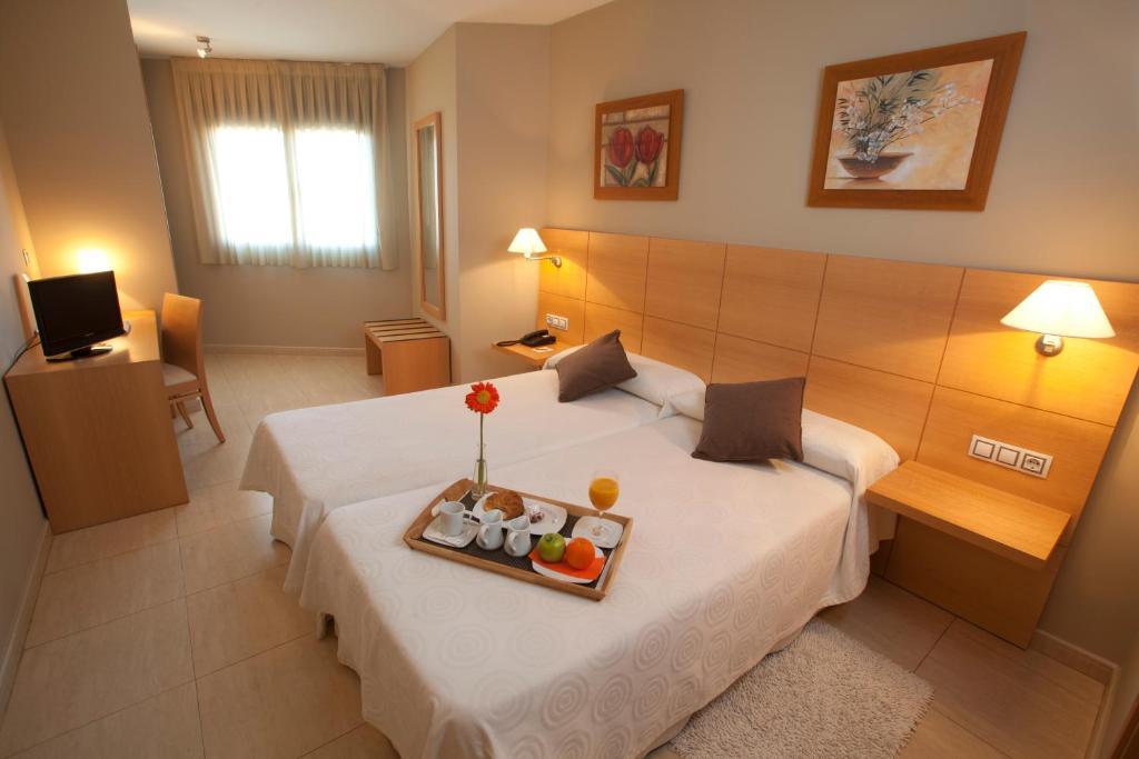 A bed or beds in a room at La City Estación