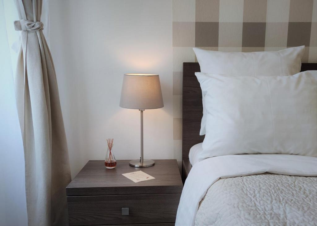 Vuode tai vuoteita majoituspaikassa Hotel Residence Spalena