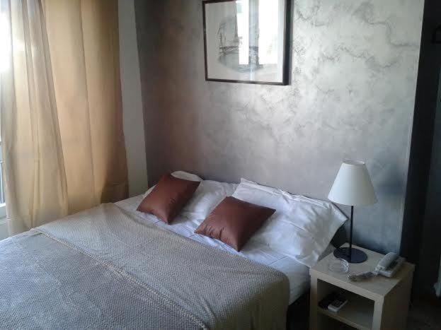 Letto o letti in una camera di Hotel Riviera Sanremo
