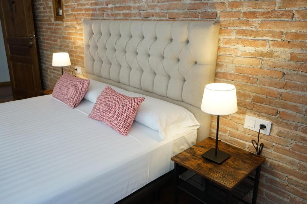 Cama o camas de una habitación en Fonda Biayna