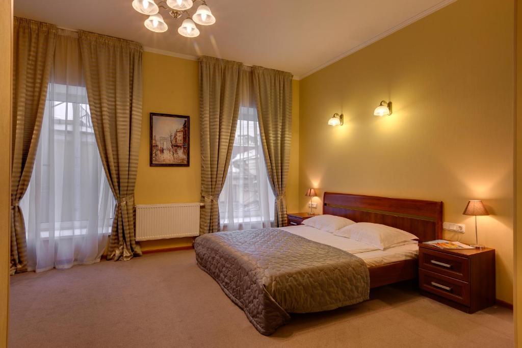 Cama ou camas em um quarto em Sonata Nevsky 11 Palace Square