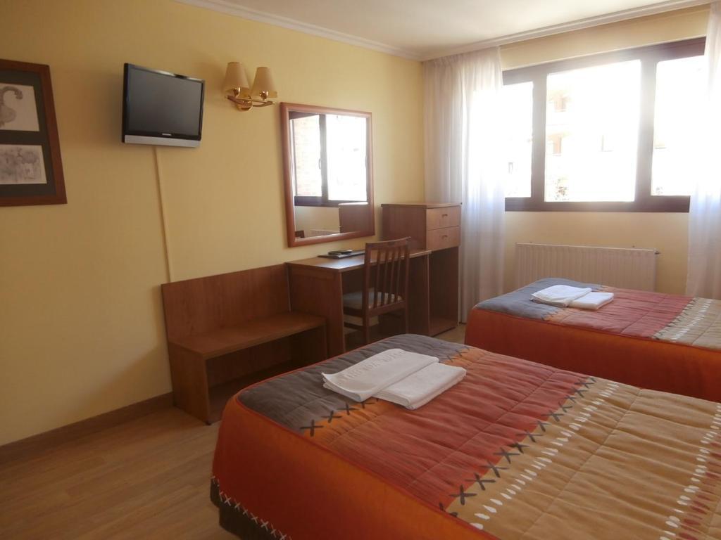 A bed or beds in a room at Hostal El Volante