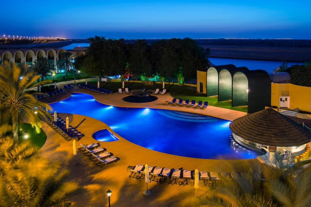 A view of the pool at Golden Tulip Al Jazira Hotel & Resort or nearby