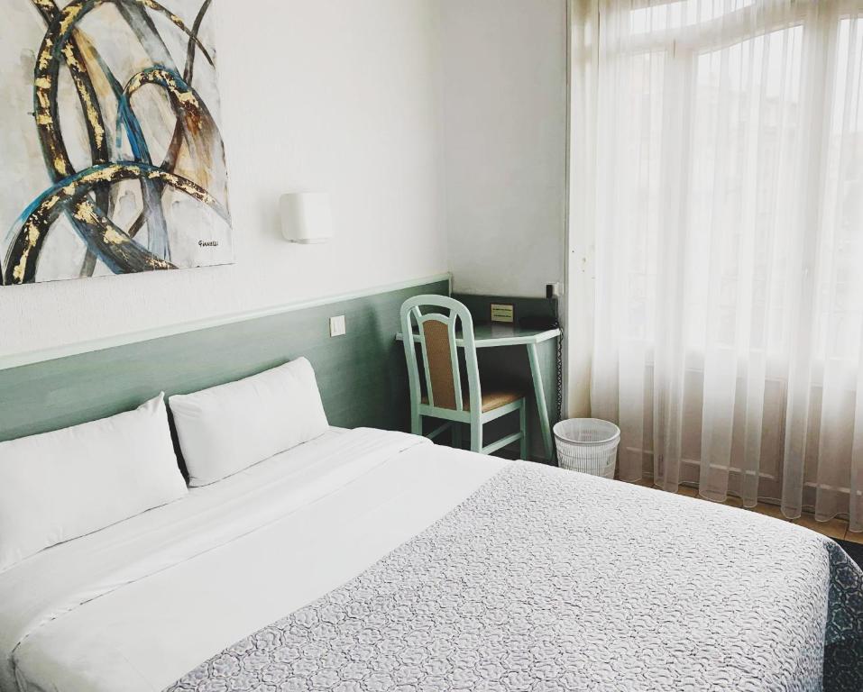 Un ou plusieurs lits dans un hébergement de l'établissement Hôtel Escurial