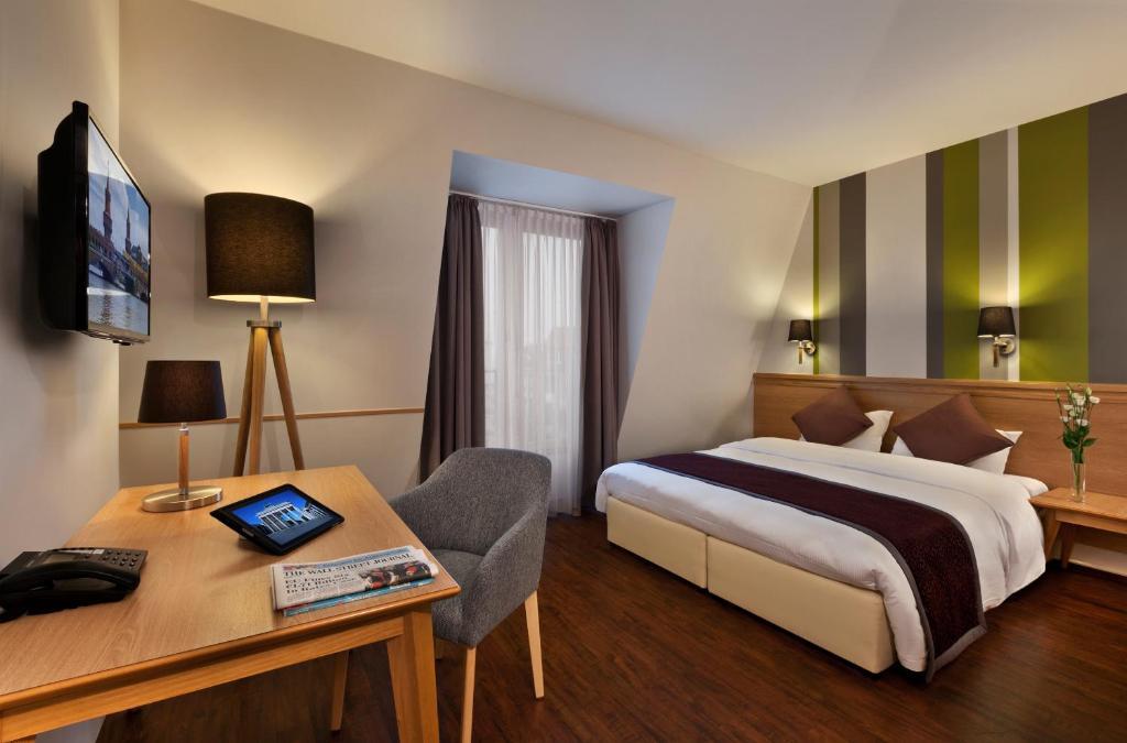 Cama o camas de una habitación en Citadines Kurfürstendamm Berlin Aparthotel