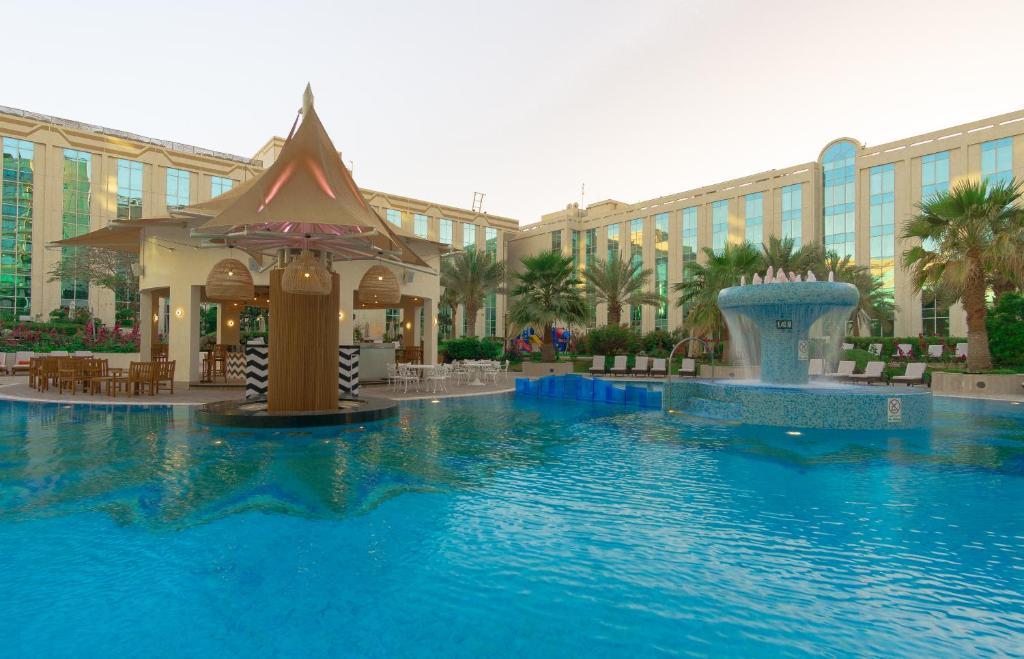 The swimming pool at or near Millennium Dubai Airport Hotel
