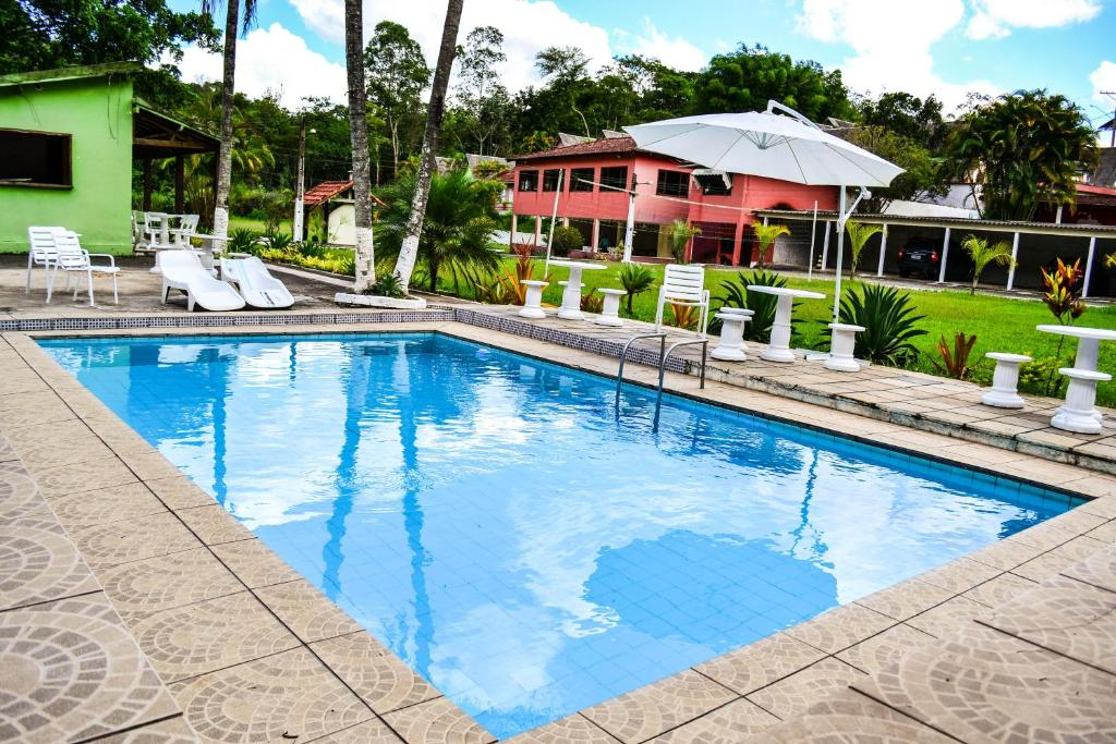 The swimming pool at or close to OYO Vale Verde Penedo Hotel