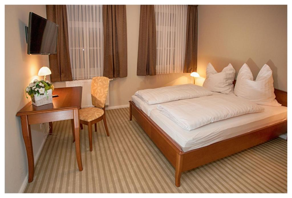 A bed or beds in a room at Postillion