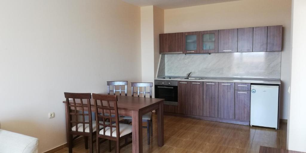 Кухня или кухненски бокс в Private Apartment in Magic Dreams