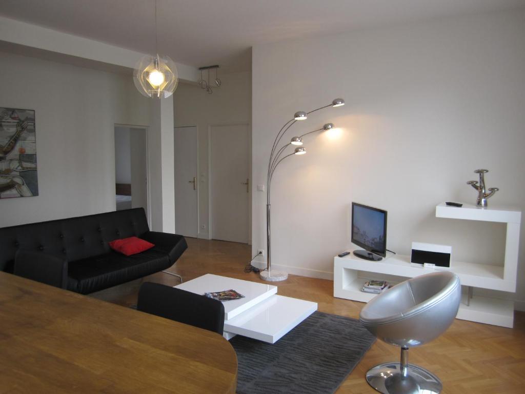 A seating area at Paris Appartements Services - Les Appartements du Marais