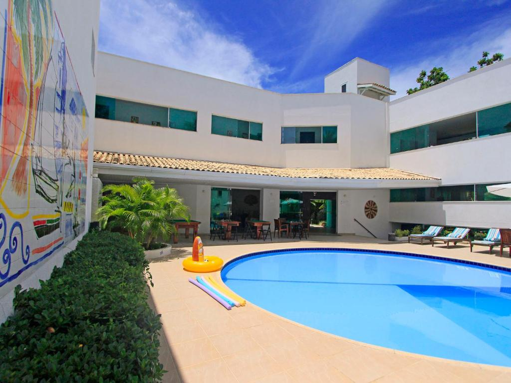 The swimming pool at or near Farol de Itapuã Praia Hotel
