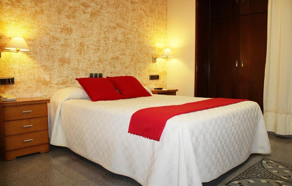 Cama o camas de una habitación en Hotel La Paz