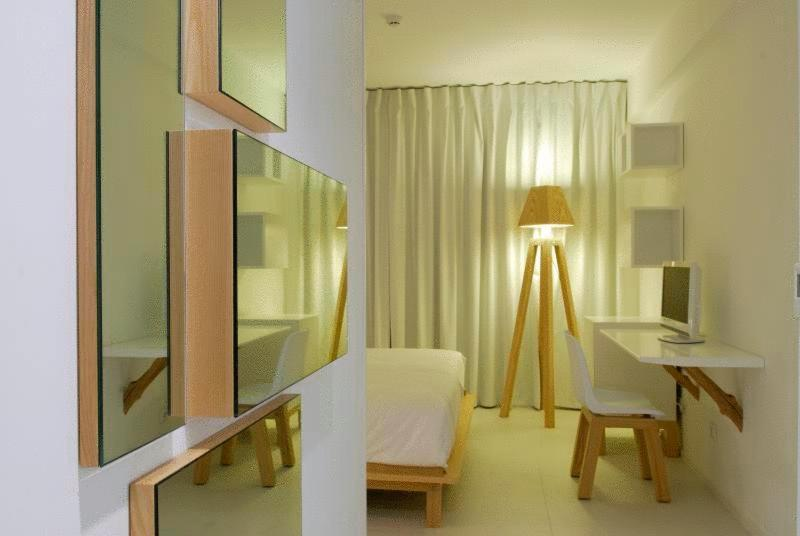 Een bed of bedden in een kamer bij Hotel Da Vila