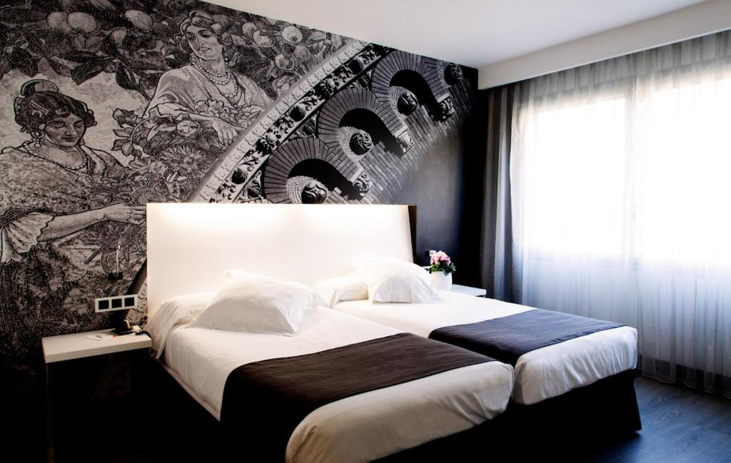 A bed or beds in a room at Hotel Dimar