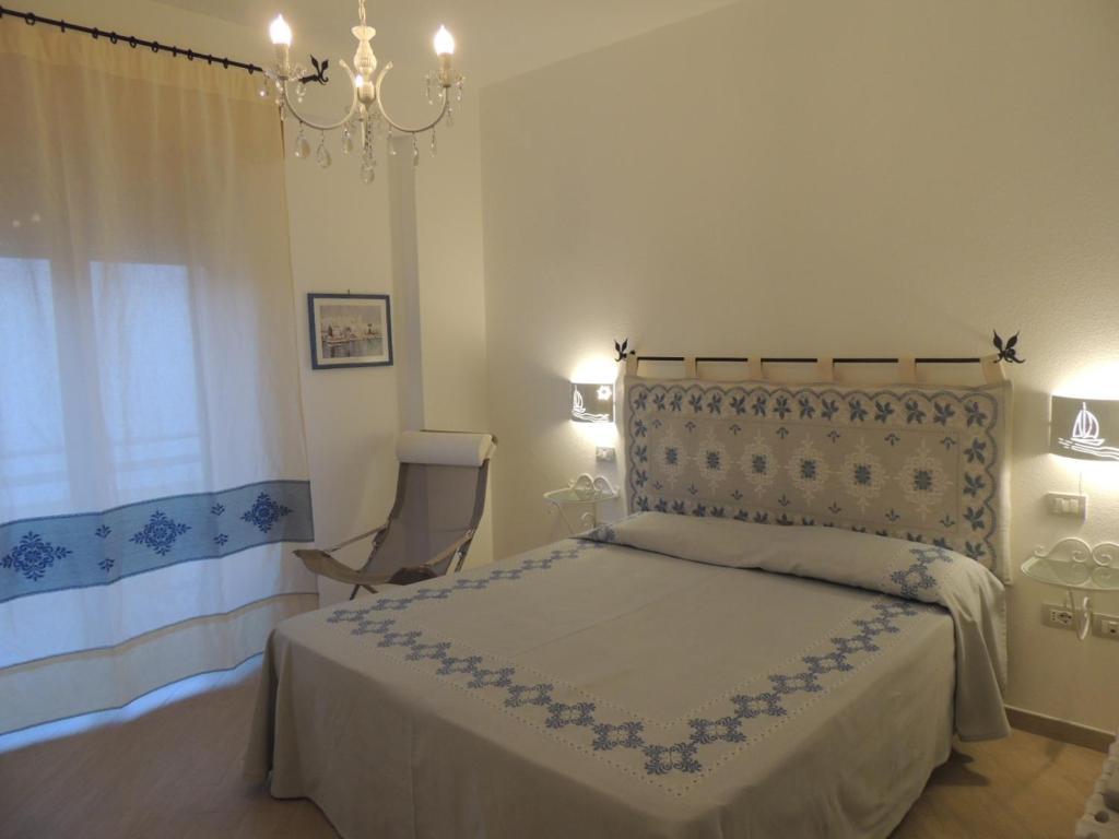 Un ou plusieurs lits dans un hébergement de l'établissement Camera con Vista