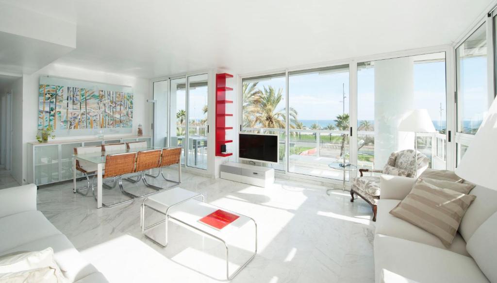 Ein Sitzbereich in der Unterkunft You Stylish Beach Apartments