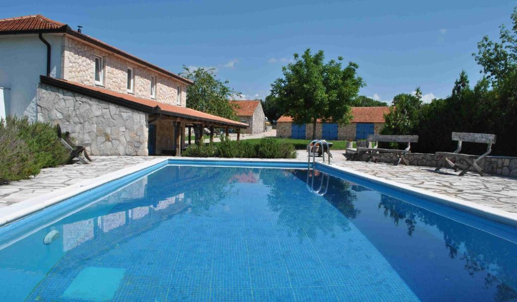 The swimming pool at or near Country House Marića Gaj