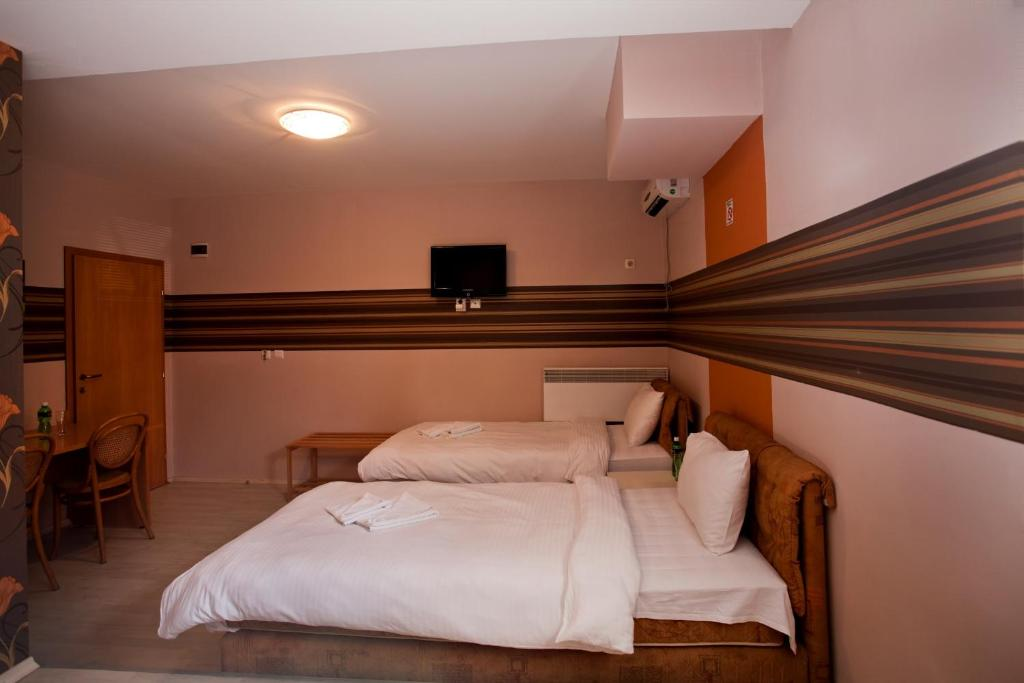 เตียงในห้องที่ Pansion Bianko - Anja