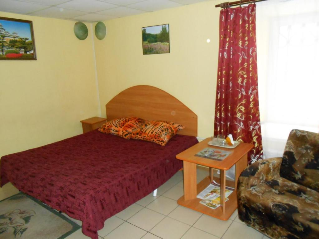 Кровать или кровати в номере Гостевой дом Рандеву