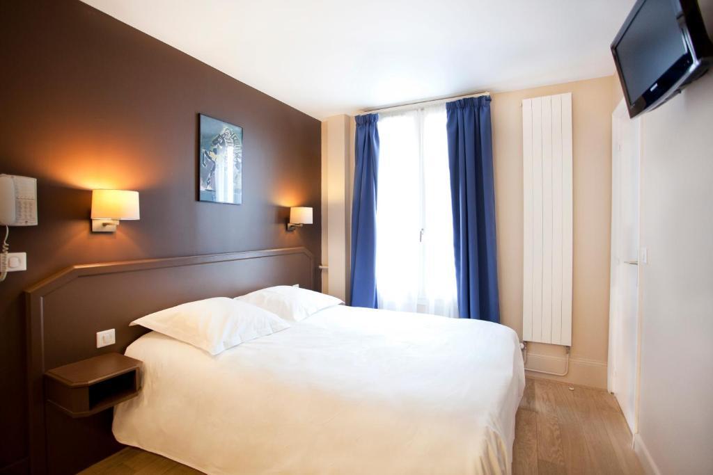 Un ou plusieurs lits dans un hébergement de l'établissement Nadaud Hotel