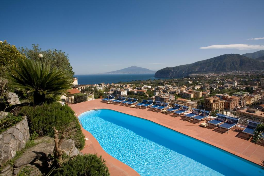 The swimming pool at or near Hotel Cristina