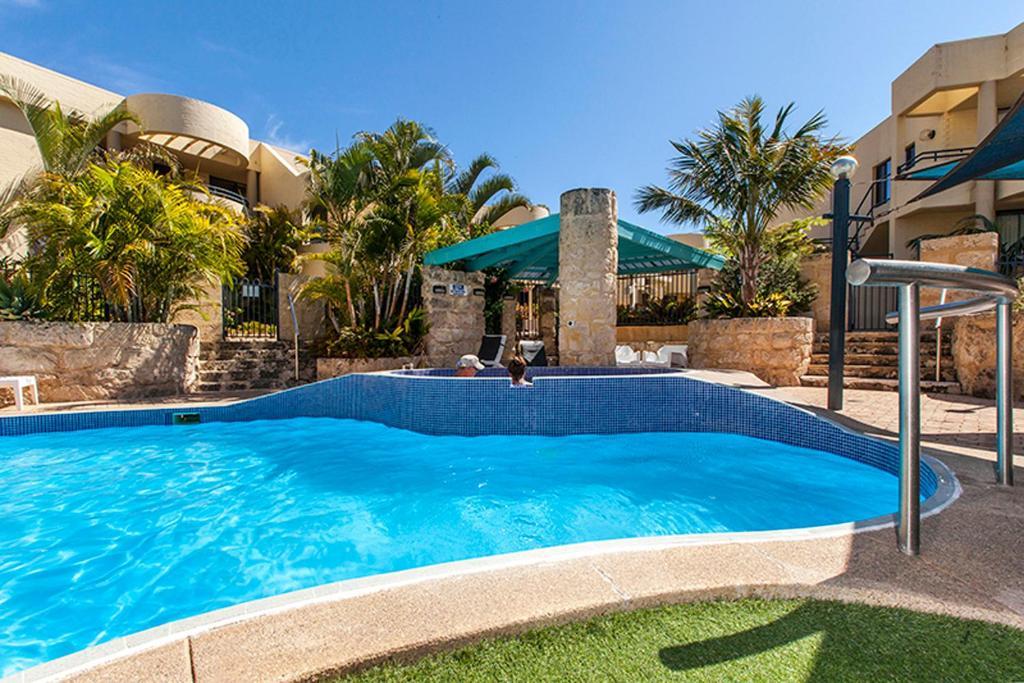 The swimming pool at or near Silver Sands Resort Mandurah