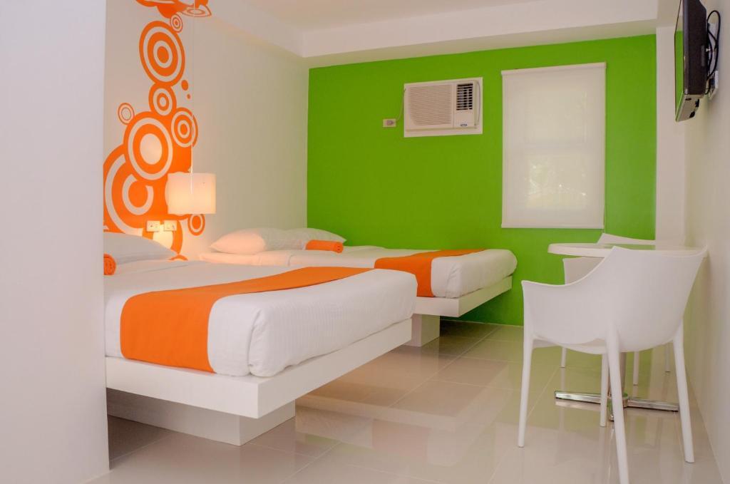 Cama o camas de una habitación en Islands Stay Hotel - Puerto Princesa
