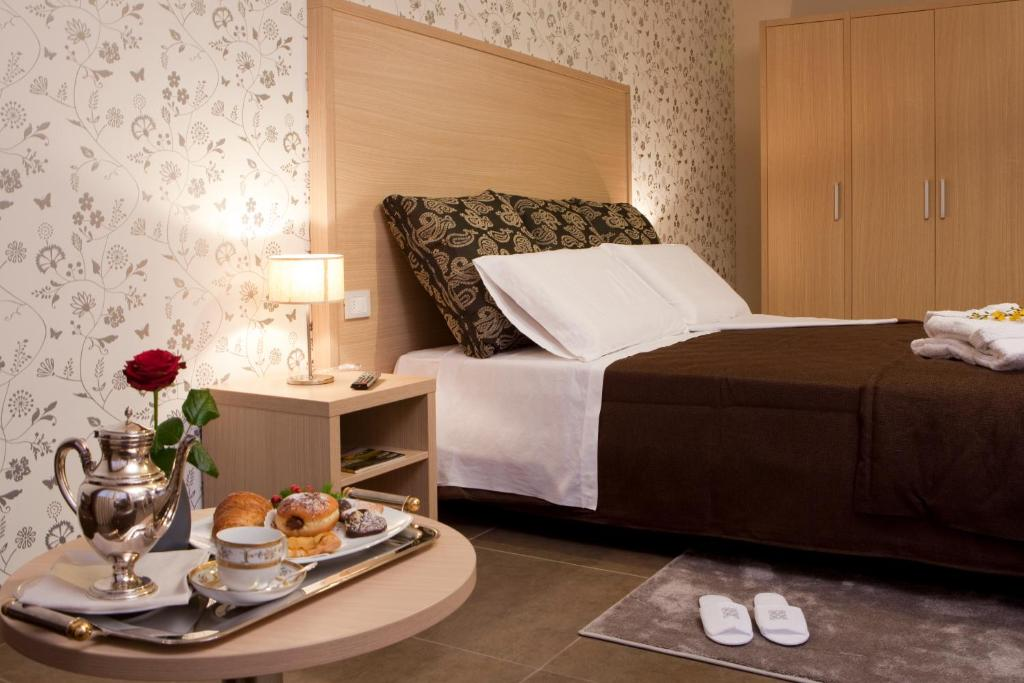 A bed or beds in a room at Hotel Torre Del Sud
