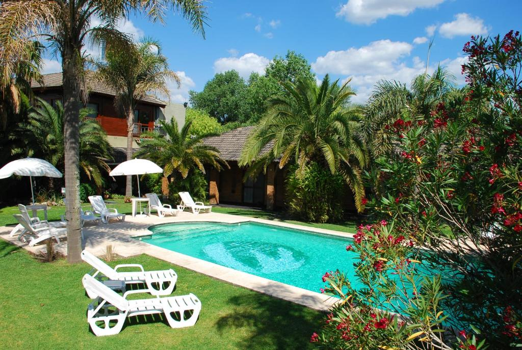 The swimming pool at or near Posada del Remanso