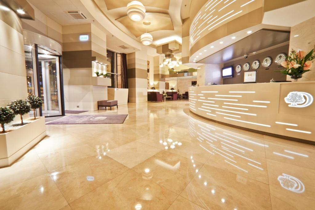 The lobby or reception area at DoubleTree by Hilton Bucharest Unirii Square