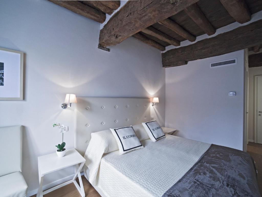 Un ou plusieurs lits dans un hébergement de l'établissement B&B Il Corso