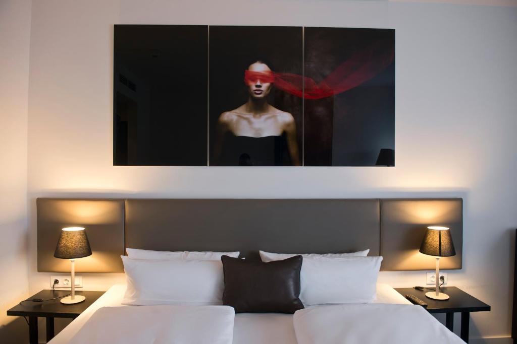 Ein Bett oder Betten in einem Zimmer der Unterkunft Wyndham Stuttgart Airport Messe
