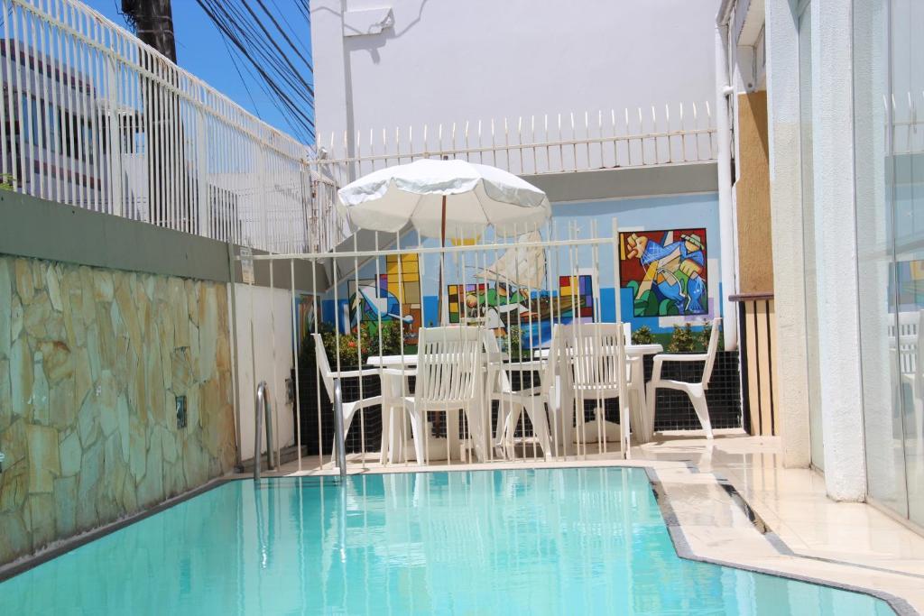 The swimming pool at or near Hotel Jangadeiro