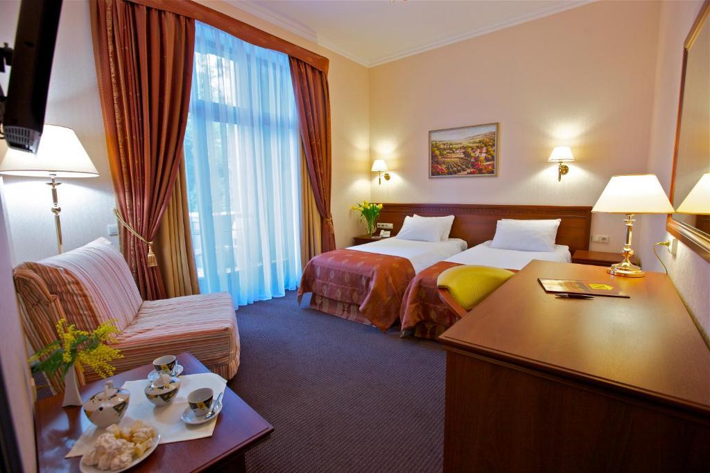 Кровать или кровати в номере Санаторий «Металлург»