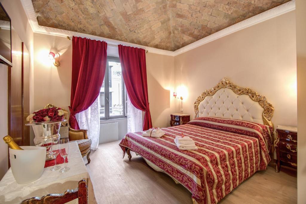 Cama ou camas em um quarto em La Reggia dei Principi