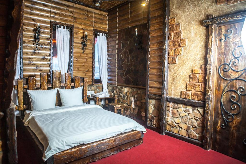 Кровать или кровати в номере Загородный комплекс Саид