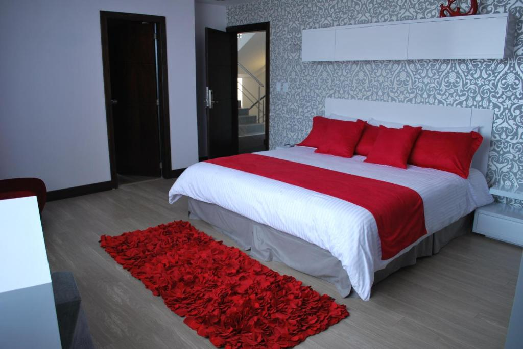 A bed or beds in a room at Rioné Hotel Boutique