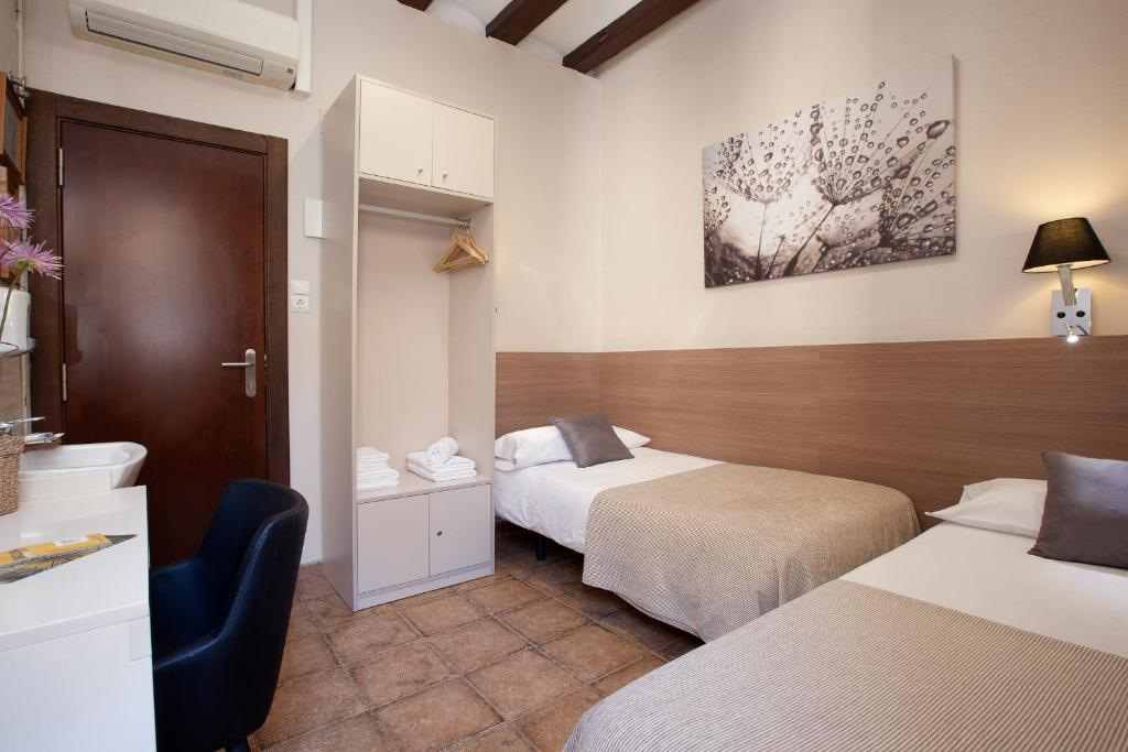 Llit o llits en una habitació de Pensión Mariluz