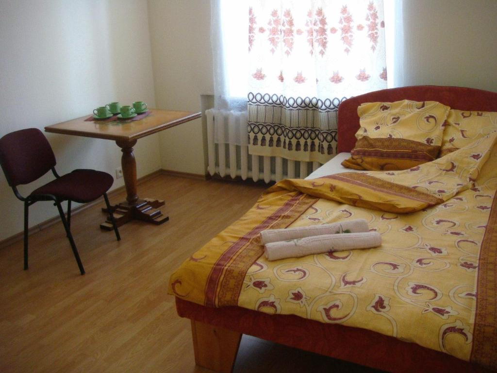 A bed or beds in a room at Cheap & Good Apartments