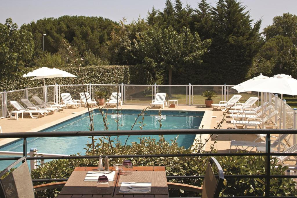 A view of the pool at Kyriad Montpellier Est - Lunel or nearby
